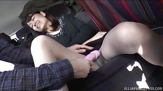Brunette Japanese of age MILF teased with respect to toys here a railway carriage